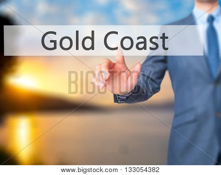 Gold Coast - Businessman Hand Pressing Button On Touch Screen Interface.