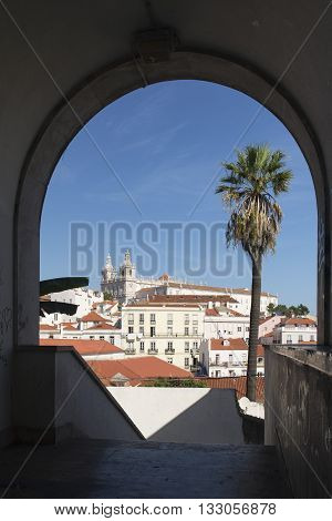 Saint Vincent convent view throught an arch in Alfama at Lisbon Portugal