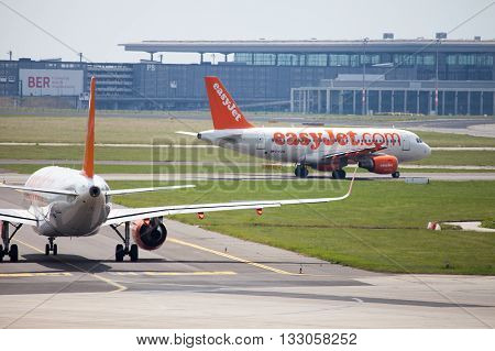 BERLIN / GERMANY - JUNE 4 2016: two Airbus A 320 - 214 from easyJet on airport Schoenefeld Berlin / Germany on june 4 2016