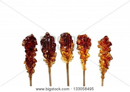 Close up of five brown sugar stirrers isolated on white.