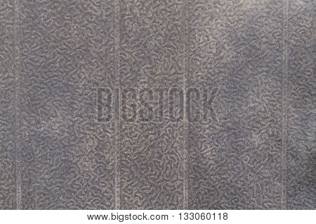 Black metal plate with bumpy surface closeup
