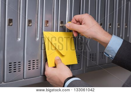 Man in suit checking mails in the mailbox