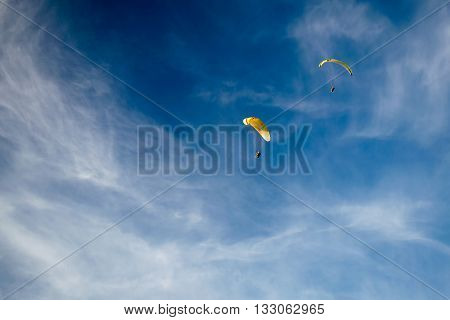 Paraglider in the sky, paraglider on a blue background
