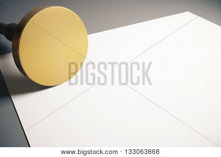 Golden round stamper and blank paper sheet on grey background. Mock up 3D Rendering