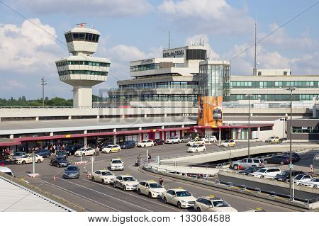 BERLIN - JUN 1 2016: Taxi's in front of the airport terminal of Berlin-Tegel airport. This airport is the main international airport of Berlin.