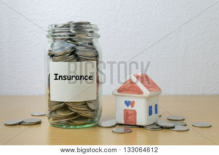 Money saving for Insurance in the glass bottle