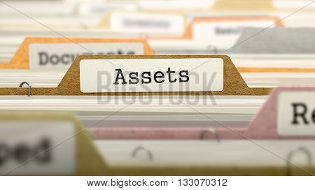 File Folder Labeled as Assets in Multicolor Archive. Closeup View. Blurred Image. 3D Render.