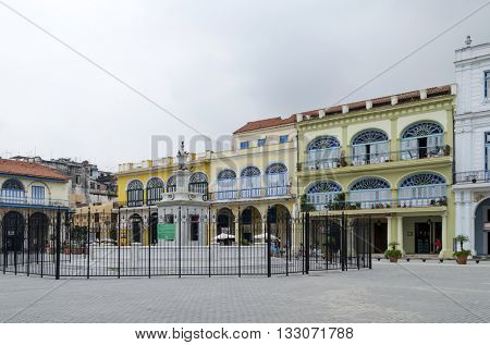 HAVANA - DECEMBER 10: Renovated old buildings at famous Plaza Vieja square on 10 December 2015 in Havana, Cuba.