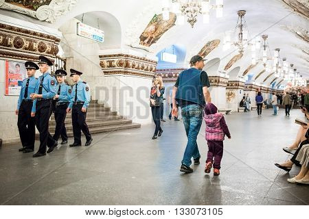 Moscow Russia - June 5 2016: Metro station Kievskaya. Patrol brigade and passangers on the platform.