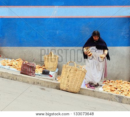LA PAZ BOLIVIA - OCTOBER 27: Ethnic woman selling the bread in steep streets to the Bolivian capital city in the La Paz in South America in October 27 2011