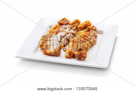 Crispy Pork Slice On Dish Isolated On White Background