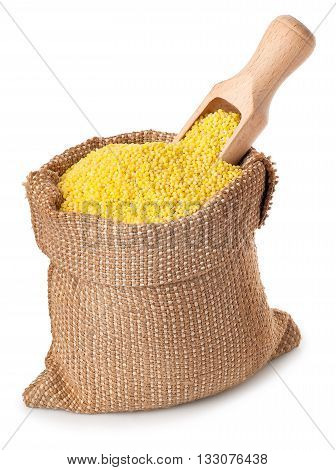 Millet with wooden scoop burlap sack isolated on white background. Millet in burlap sack