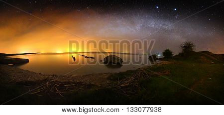 Night landscape with the Milky Way above the lake