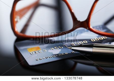 Credit card with glasses, close up