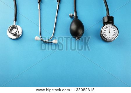 Medical manometer and a stethoscope on blue background