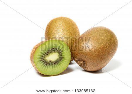 juicy kiwi fruit and sliced segments isolated on white background