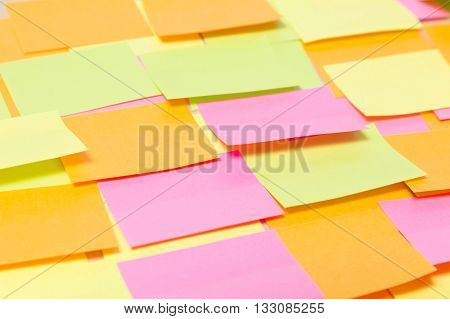 Close up of many colorful stickers on wood background