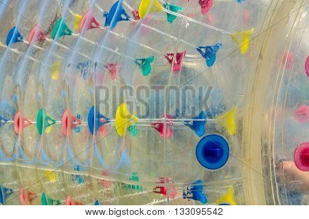 Abstract photograph of inflatable water walking orbs