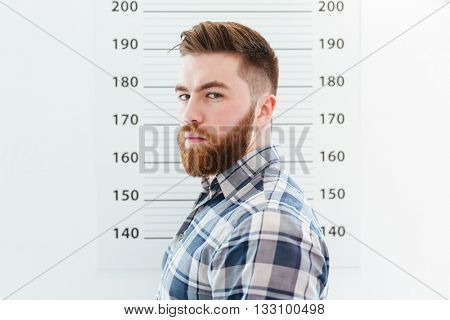Mugshot of a bearded man looking at camera