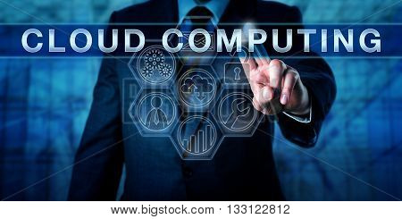 Manager is pushing CLOUD COMPUTING on an interactive touch screen. Business process metaphor and information technology concept for converged infrastructure vie internet-based computing resources.
