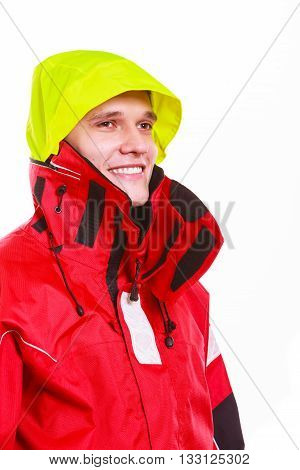 Hooded man in waterproof jacket. Young male outdoorsman in protective clothing. Adventure danger outdoors concept.