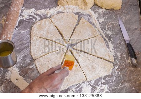 Orange silicone brush for food is lubricated dough