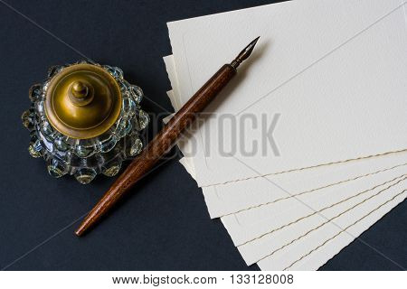 Vintage background with old fountain pen, inkwell, papers