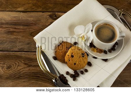 Serving tray with two coffee cups and white orchid. Coffee cup. Cup of coffee. Strong coffee. Coffee mug. Morning coffee. Coffee break.