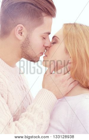Young couple in love kissing, close up