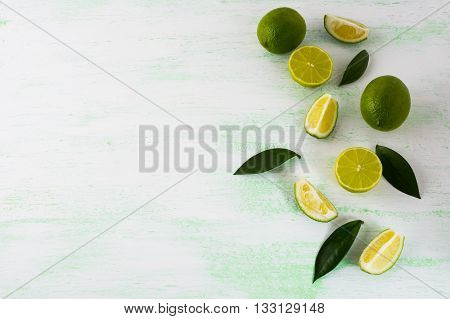 Healthy eating concept with limes and lemons. Fresh food. Vegetarian food. Fresh fruit. Mixed fruit. Fruit background. Healthy eating concept. Ripe fruit. Citrus fruit.