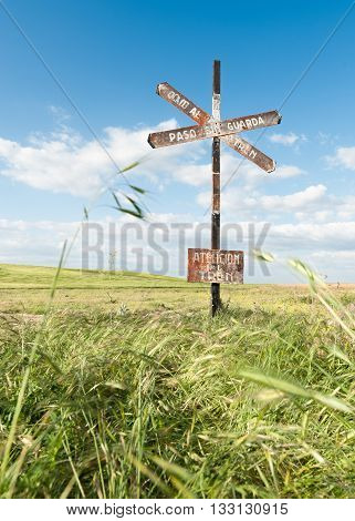aging step signal level with blue sky background and field