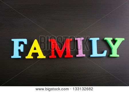 Word family on dark wooden background