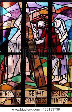KLEINOSTHEIM, GERMANY - JUNE 08: 6th Stations of the Cross, Veronica wipes the face of Jesus, stained glass window in Saint Lawrence church in Kleinostheim, Germany on June 08, 2015.