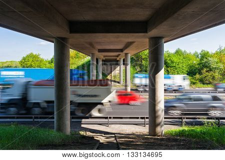 Cars in Motion On Busy Motorway under the Bridge