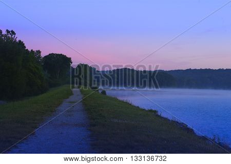 Predawn at Barton Pond in Ann Arbor, Michigan.  Beautiful high contrast morning light along the water front.