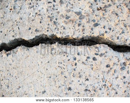 closeup cement road surface crack and rough