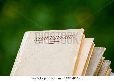 A Shakespeare Book on Blurred Green Background