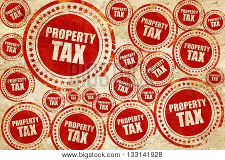 property tax, red stamp on a grunge paper texture