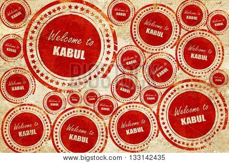 Welcome to kabul, red stamp on a grunge paper texture