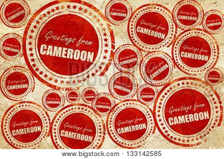 Greetings from cameroon, red stamp on a grunge paper texture