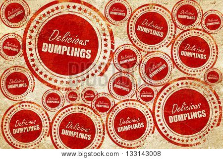 Delicious dumplings sign, red stamp on a grunge paper texture