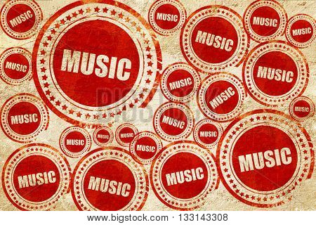 music, red stamp on a grunge paper texture