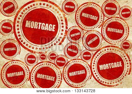 mortgage, red stamp on a grunge paper texture