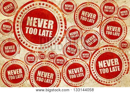 never too late, red stamp on a grunge paper texture