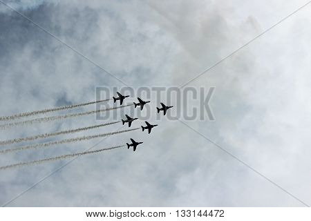 A group of flight fighters flying in a show