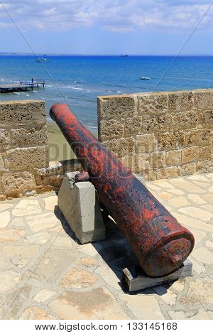 Old gun in Larnaka Medieval Castle over sea, Cyprus