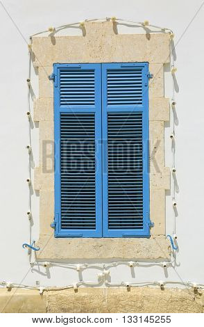 Blue vintage window and white wall