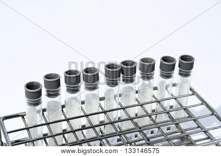 Gray laboratory tube with stainless rack on the white background.