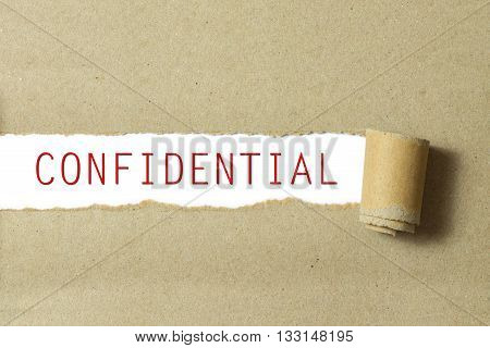 Red color confidential word written on torn paper white background poster