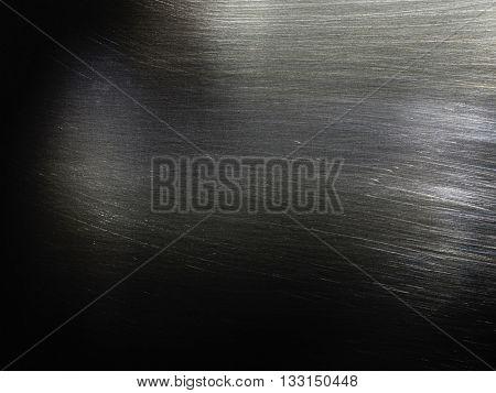 Metal texture background. Macro photo of brushed metal.